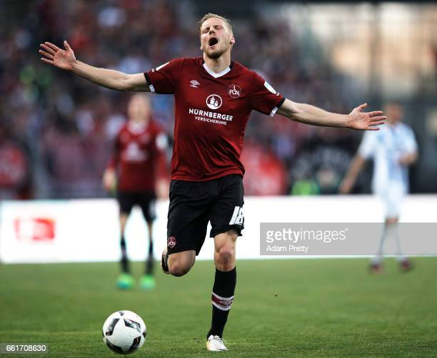 Hanno Behrens of 1FC Nuernberg reacts to a decision during the Second Bundesliga match between 1 FC Nuernberg and Karlsruher SC at Arena Nuernberg on...