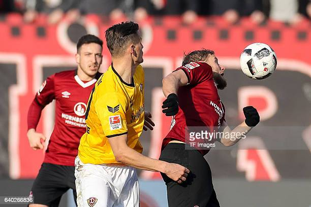 Hanno Behrens of FC Nuernberg and Stefan Kutschke of Dynamo Dresden battle for the ball during the Second Bundesliga match between 1 FC Nuernberg and...
