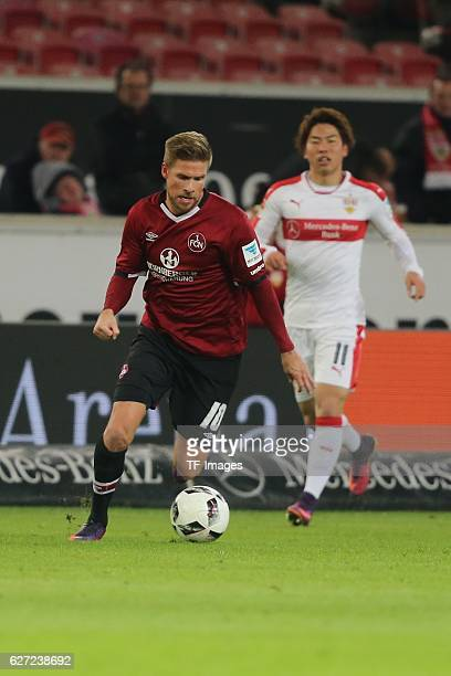 Hanno Behrens of Nuerenberg and Takuma Asano of Suttgart battle for the ball during the second Bundesliga match between VfB Stuttgart and 1 FC...