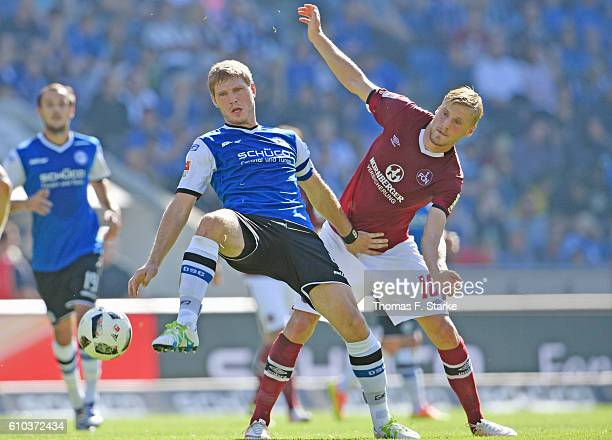 Hanno Behrens of Nuernberg and Fabian Klos of Bielefeld fight for the ball during the Second Bundesliga match between DSC Arminia Bielefeld and 1 FC...