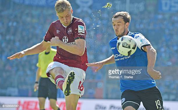 Hanno Behrens of Nuernberg and Manuel Prietl of Bielefeld fight for the ball during the Second Bundesliga match between DSC Arminia Bielefeld and 1...