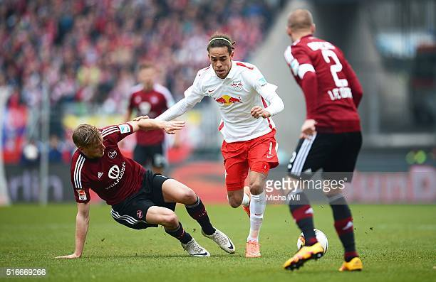 Hanno Behrens of Nuernberg and Yussuf Poulsen of Leipzig compete for the ball during the Second Bundesliga match between 1 FC Nuernberg and RB...