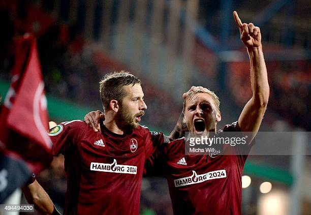 Hanno Behrens of Nuernberg celebrates with Guido Burgstaller of Nuernberg after scoring his team's second goal during the DFB Cup match at...