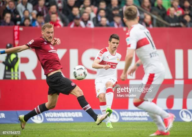 Hanno Behrens of Nuernberg is challenged by Josip Brekalo of Stuttgart during the Second Bundesliga match between 1 FC Nuernberg and VfB Stuttgart at...
