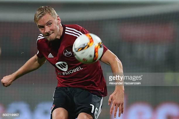 Hanno Behrens of Nuernberg runs with the ball during the Second Bundesliga match between 1 FC Nuernberg and SC Paderborn 07 at GrundigStadion on...
