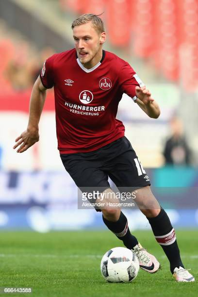 Hanno Behrens of Nuernberg runs with the ball during the Second Bundesliga match between 1 FC Nuernberg and FC St Pauli at Arena Nuernberg on April 7...