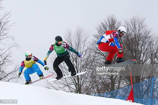 Hanno Douschan of Austria Jarryd Hughes of Australia and Pierre Vaultier of France compete in the Men's Snowboard Cross 1/8 Finals on day eleven of...