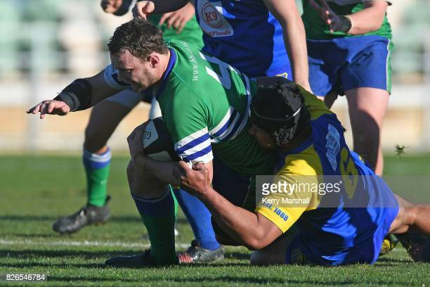Hannon Brighouse of Napier Old Boys Marist is tackled by Api Sione of Clive during the Madison Trophy Final match between Napier Old Boys Marist and...