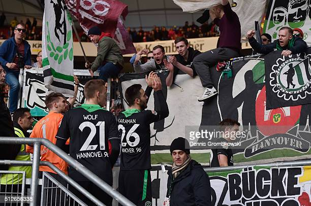 Hannover 96 players celebrate their victory in the Bundesliga match between VfB Stuttgart and Hannover 96 at MercedesBenz Arena on February 27 2016...