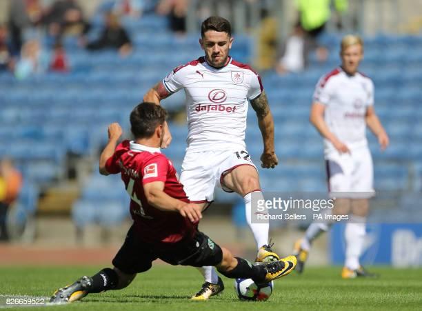 Hannover 96's Julian Korb challenges Burnley's Robbie Brady during the preseason friendly match at Turf Moor Burnley