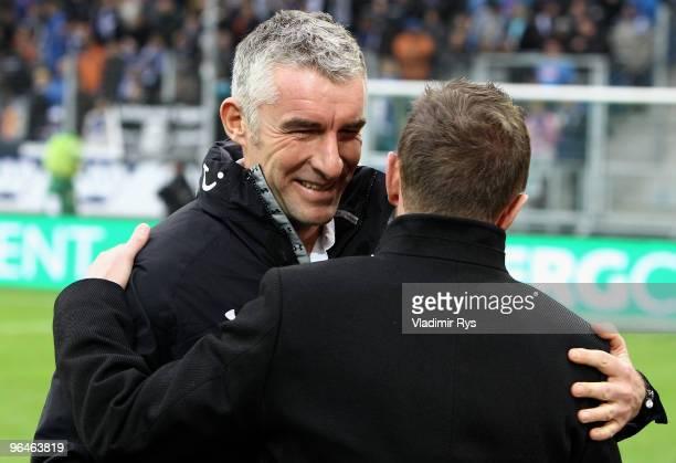 Hannover coach Mirko Slomka gives a hug to Hoffenheim coach Ralf Rangnick ahead the Bundesliga match between 1899 Hoffenheim and Hannover 96 at...