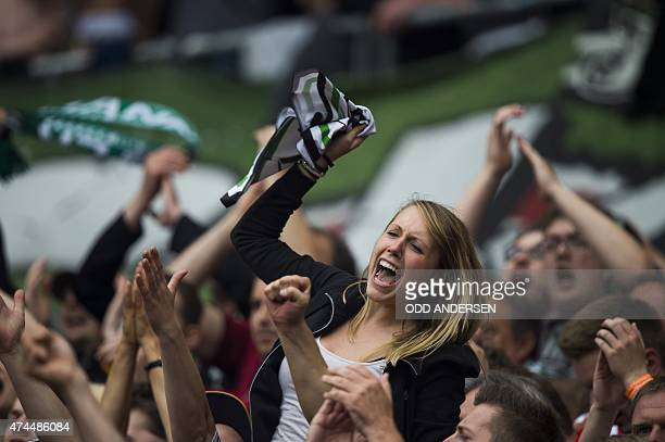 Hannover fans celebrate at the final whistle of the German first division Bundesliga football match between Hannover and Freiburg in Hannover on May...