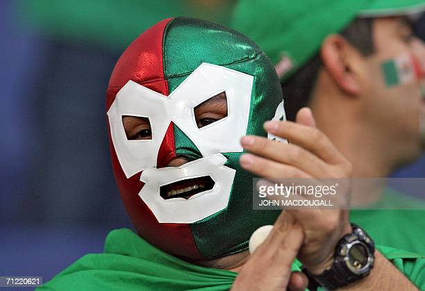 A Mexican supporter wearing wrestling masks cheers prior to the start of the 2006 World Cup Group D football match Mexico vs Angola 16 June 2006 in...