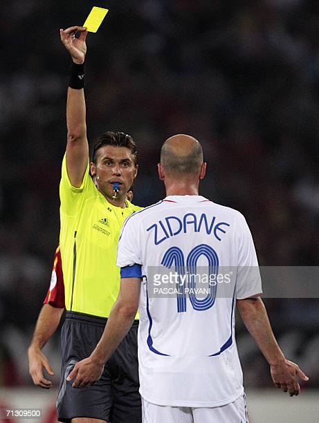 Italian referee Roberto Rosetti shows the yellow card to French midfielder Zinedine Zidane during the World Cup 2006 round of 16 football game Spain...
