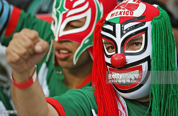 Mexican supporters wearing wrestling masks cheer prior to the start of the 2006 World Cup Group D football match Mexico vs Angola 16 June 2006 in...