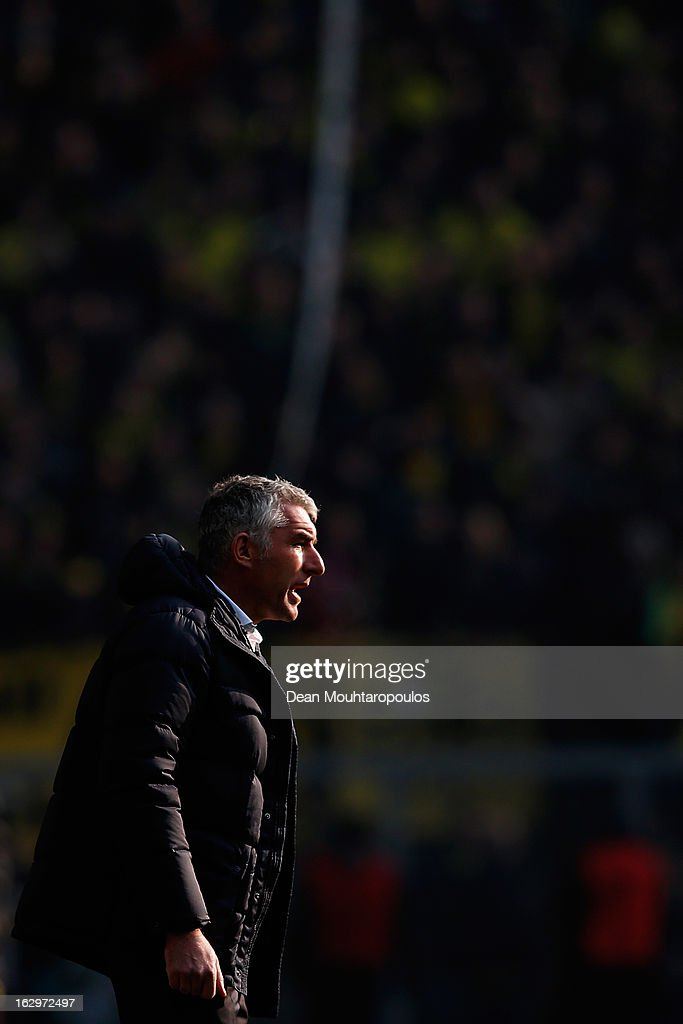 Hannover Manager, <a gi-track='captionPersonalityLinkClicked' href=/galleries/search?phrase=Mirko+Slomka&family=editorial&specificpeople=874525 ng-click='$event.stopPropagation()'>Mirko Slomka</a> shouts instructions from the sidelines during the Bundesliga match between Borussia Dortmund and Hannover 96 at Signal Iduna Park on March 2, 2013 in Dortmund, Germany.