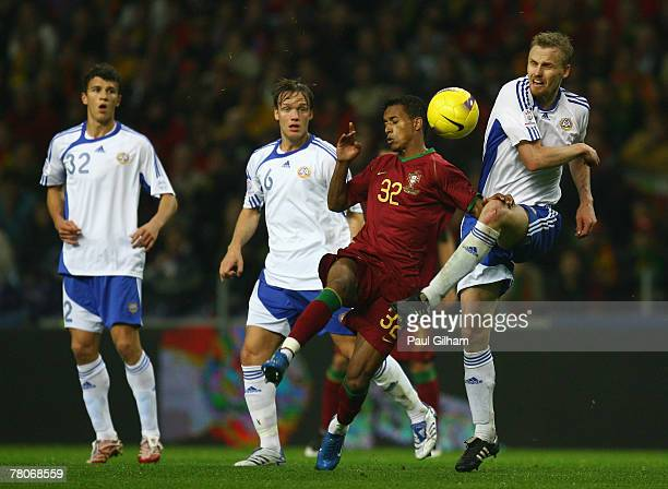 Hannu Tihinen of Finland battles for the ball with Nani of Portugal during the UEFA Euro2008 Group A Qualifying match between Portugal and Finland at...