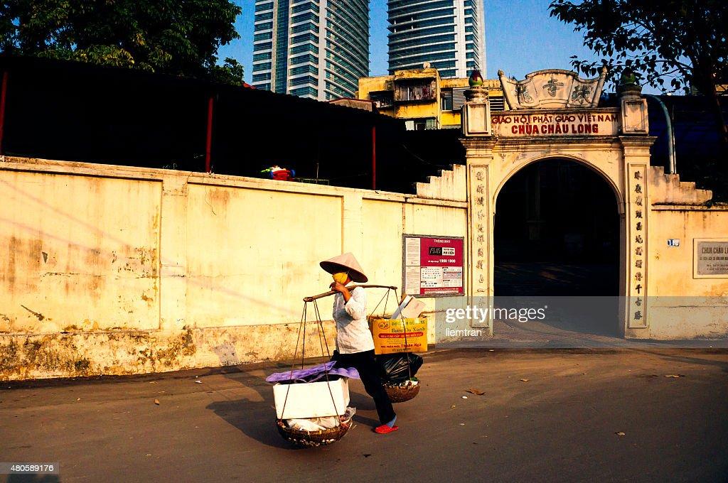 Hanoi street vendor : Stock Photo