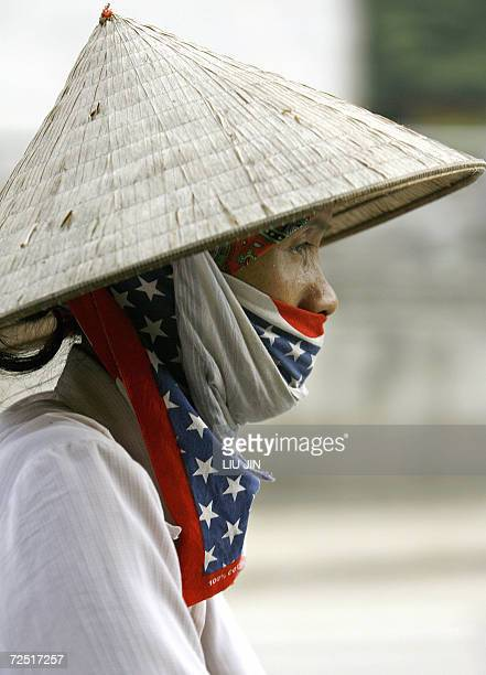 A woman motorcyclist wears a scarf painted with the US flag along a street in Hanoi 13 November 2006 The AsiaPacific Economic Cooperation summit 1619...