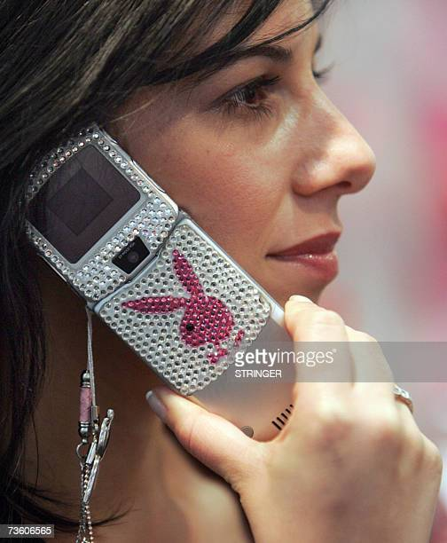 A woman speaks on a mobile phone with the Playboy logo at the CeBIT computer digital IT and telecommunications fair 16 March 2007 at the fair grounds...
