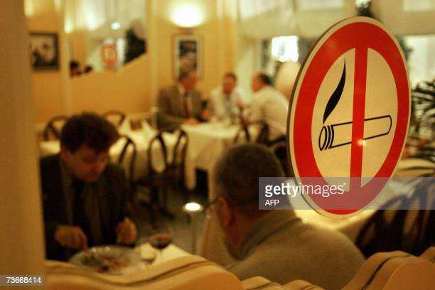 FILES Picture taken 20 February 2007 shows a non smoking sign on a window of a restaurant which has a smoker's and a nonsmoking area in Hanover...