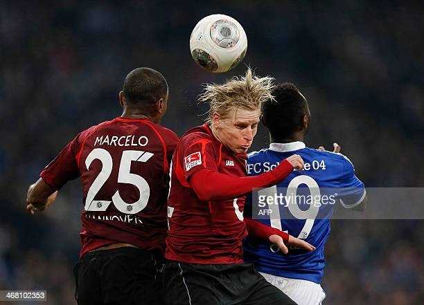 Hanover's Brazilian defender Marcelo and Frantisek Rajtoral vie for the ball with Schalke's Nigerian striker Chinedu Obasi during the German first...