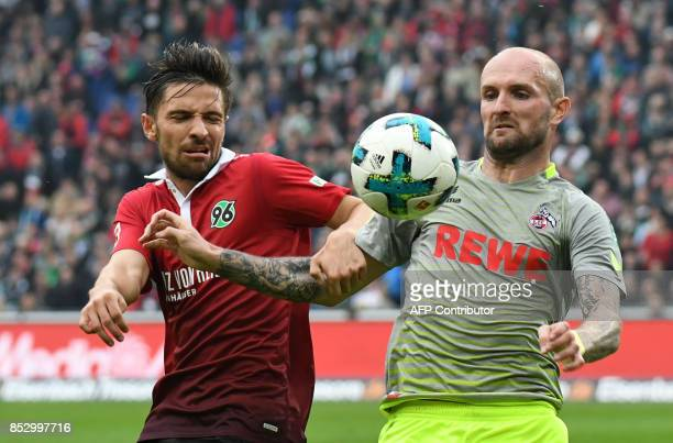 Hanover's German defender Julian Korb and Cologne's Russian defender Konstantin Rausch vie for the ball during the German first division Bundesliga...