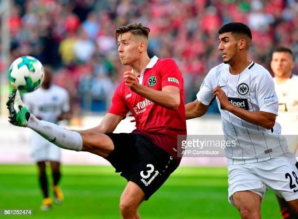 Hanover's German defender Waldemar Anton and Frankfurt's German midfielder Aymen Barkok vie for the ball during the German First division Bundesliga...