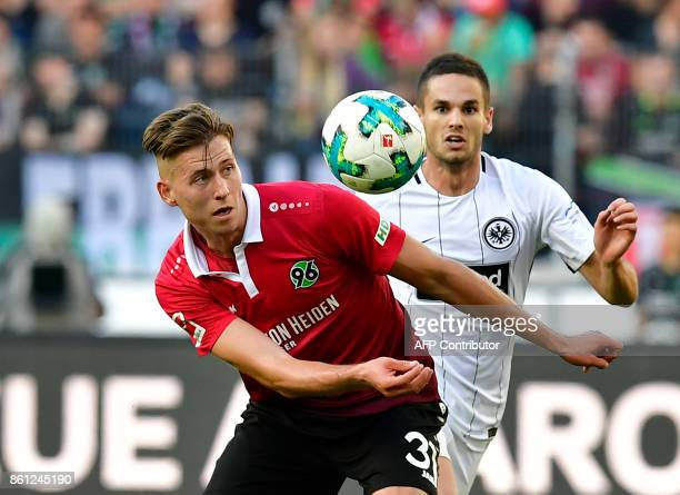 Hanover's German defender Waldemar Anton and Frankfurt's Serbian midfielder Mijat Gacinovic vie for the ball during the German First division...