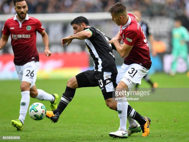 Hanover's German defender Waldemar Anton and Moenchengladbach's German forward Lars Stindl vie for the ball during the German First division...