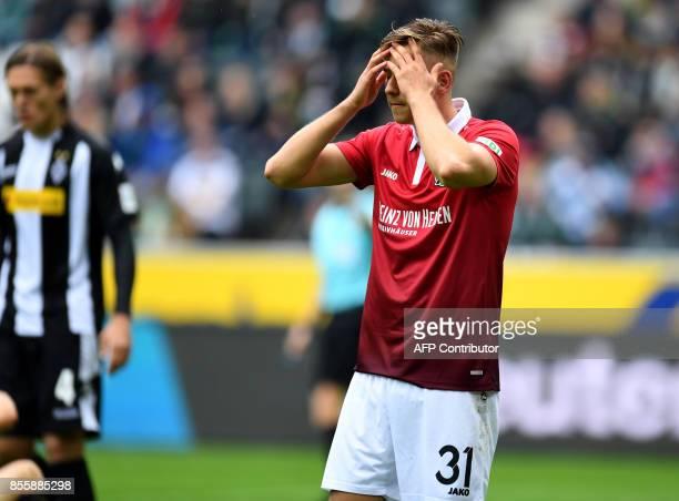 Hanover's German defender Waldemar Anton reacts during the German first division Bundesliga football match between Borussia Moenchengladbach and...