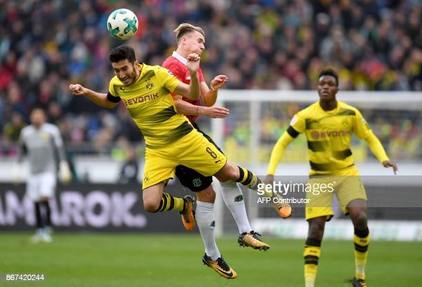Hanover's German forward Felix Klaus and Dortmund's Turkish midfielder Nuri Sahin vie for the ball during the German First division Bundesliga...