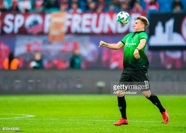 Hanover's German forward Felix Klaus plays the ball during the German first division Bundesliga football match RB Leipzig vs Hannover 96 in Leipzig...