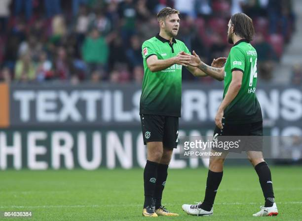 Hanover's German forward Niclas Fuellkrug and Hanover's Austrian forward Martin Harnik react after the German first division Bundesliga football...