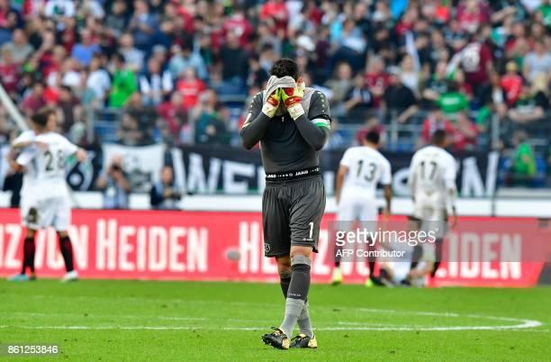 Hanover's German goalkeeper Philipp Tschauner reacts after the German First division Bundesliga football match Hannover 96 vs Eintracht Frankfurt in...