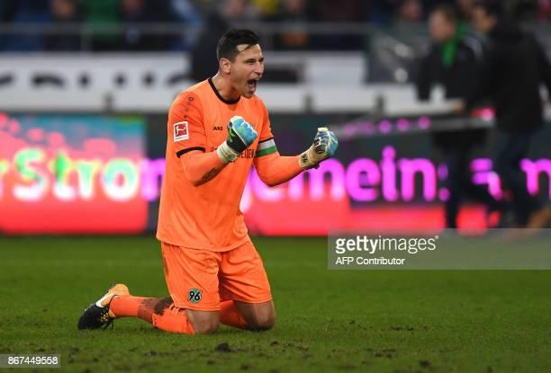 Hanover's German goalkeeper Philipp Tschauner reacts after the German First division Bundesliga football match Hanover 96 vs Borussia Dortmund in...
