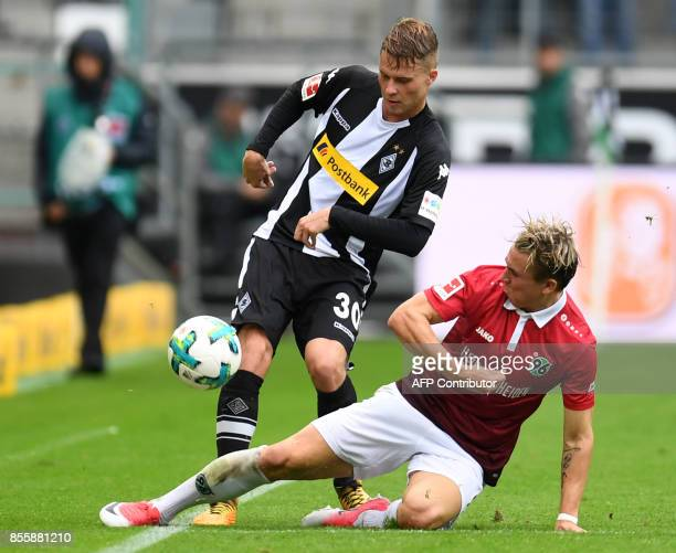 Hanover's German midfielder Marvin Bakalorz and Moenchengladbach's Swiss defender Nico Elvedi vie for the ball during the German First division...