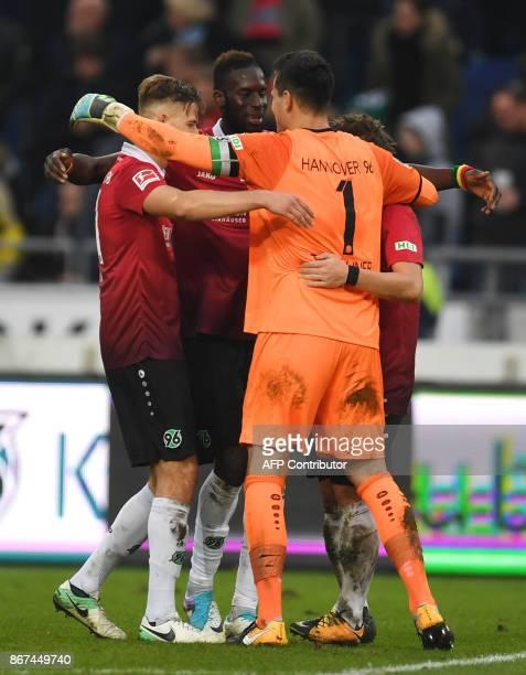 Hanover's goalkeeper Philipp Tschauner and his teammates react after the German First division Bundesliga football match Hanover 96 vs Borussia...