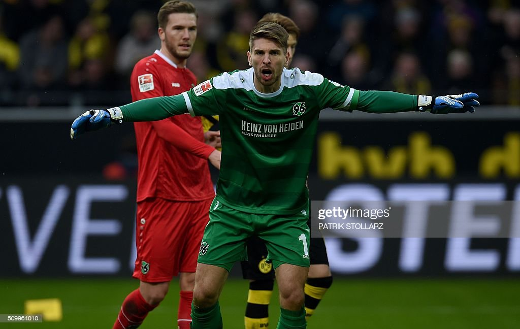 Hanover's goalkeeper Ron-Robert Zieler reacts during the German first division Bundesliga football match of Borussia Dortmund vs Hannover 96 in Dortmund, western Germany, on February 13, 2016. / AFP / PATRIK STOLLARZ /