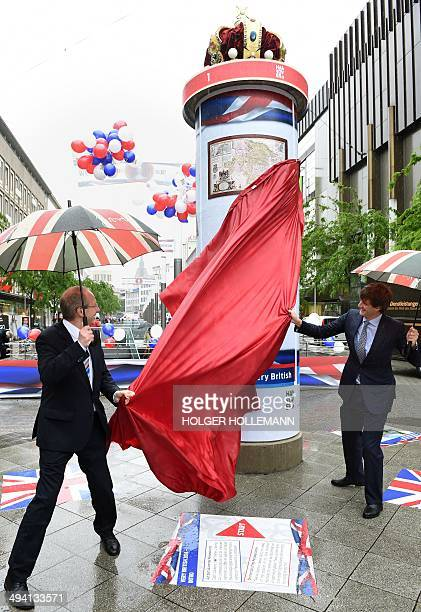 Hanover's Mayor Stefan Schostok and Prince Ernst August of Hanover unveil one of twelve advertising columns decorated with Royal crown and British...