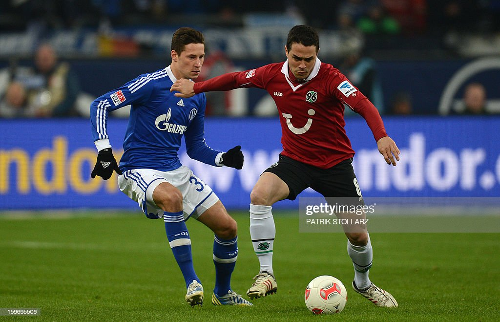 Hanover's midfielder Manuel Schmiedebach and Schalke's midfielder Julian Draxler (L) vie for the ball during the German first division Bundesliga football match FC Schalke 04 vs Hanover 96 on January 18, 2013 in Gelsenkirchen, western Germany