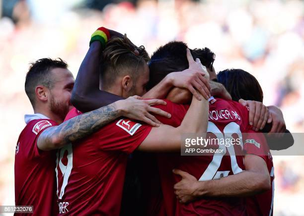 Hanover's players celebrate after scoring the 11 during the German First division Bundesliga football match Hannover 96 vs Eintracht Frankfurt in...