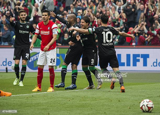 Hanover's players celebrate the 21 after an own goal by Freiburg's Czech defender Pavel Krmas next to Freiburg's Bosnian defender Mensur Mujdza...