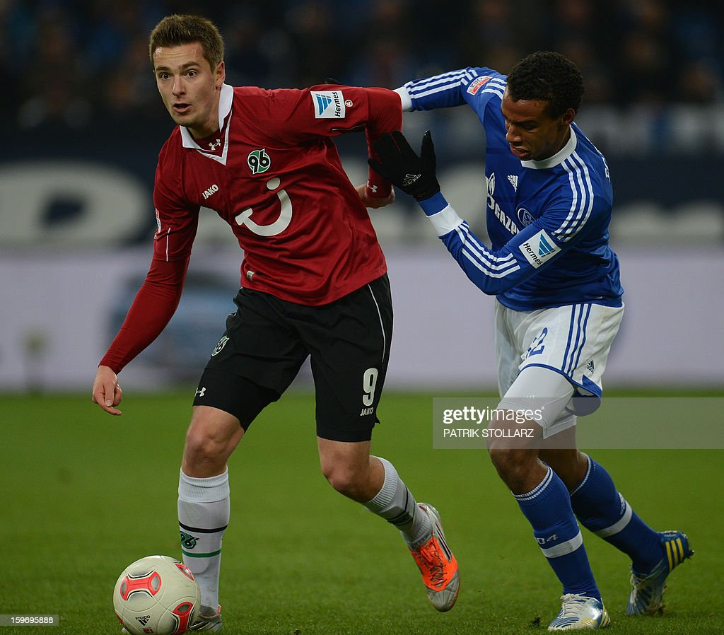 Hanover's Polish striker Artur Sobiech and Schalke's Cameroonian defender Joel Matip vie for the ball during the German first division Bundesliga football match FC Schalke 04 vs Hanover 96 on January 18, 2013 in Gelsenkirchen, western Germany