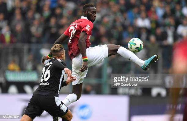 Hanover's Senegalese defender Salif Sane and Moenchengladbach's Paraguayan forward Raul Bobadilla vie for the ball during the German first division...