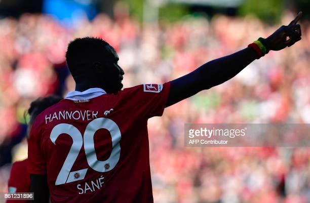 Hanover's Senegalese defender Salif Sane celebrates after scoring the 11 during the German First division Bundesliga football match Hannover 96 vs...