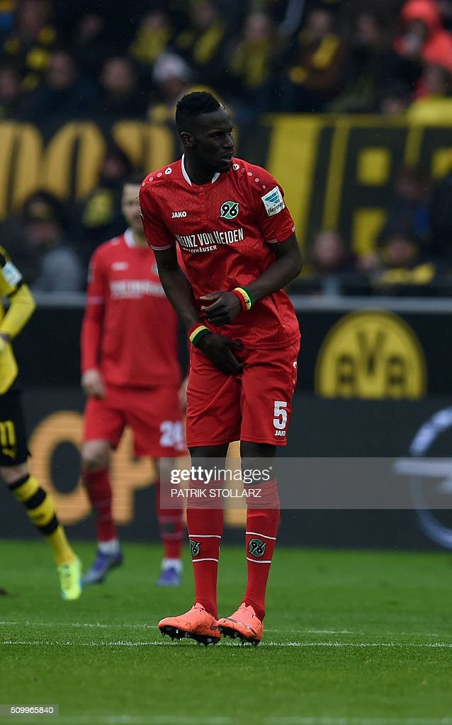 Hanover's Senegalese defender Salif Sane reacts during the German first division Bundesliga football match of Borussia Dortmund vs Hannover 96 in Dortmund, western Germany, on February 13, 2016. / AFP / PATRIK STOLLARZ /
