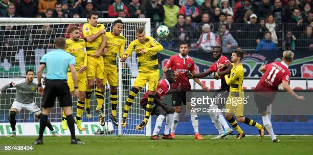 Hanover´s striker Felix Klaus scores from a freekick during the German First division Bundesliga football match Hanover 96 vs Borussia Dortmund in...