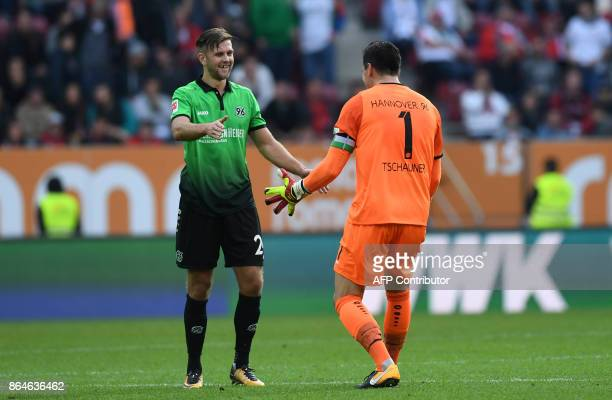 Hanover's striker Niclas Fuellkrug and goalkeeper Philipp Tschauner celebrate at the end of the German first division Bundesliga football match...