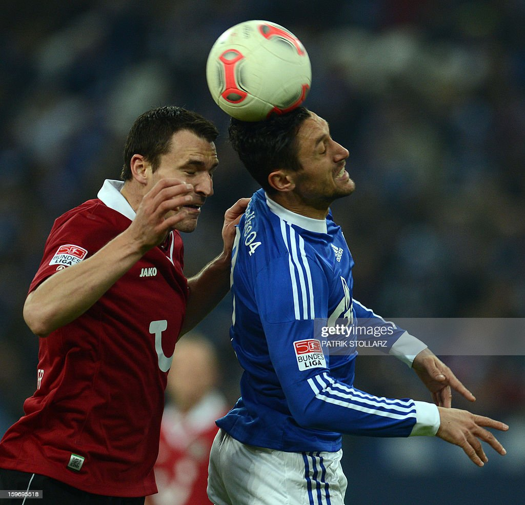 Hanover's Swiss defender Mario Eggimann and Schalke's Romanian forward Ciprian Marica vie for the ball during the German first division Bundesliga football match FC Schalke 04 vs Hanover 96 on January 18, 2013 in Gelsenkirchen, western Germany